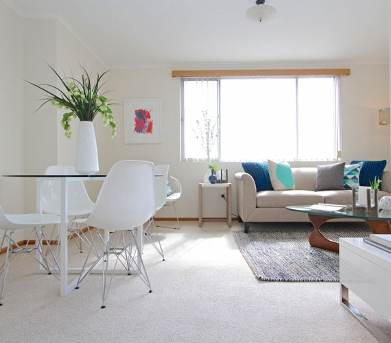 White and bright helps make the room wider