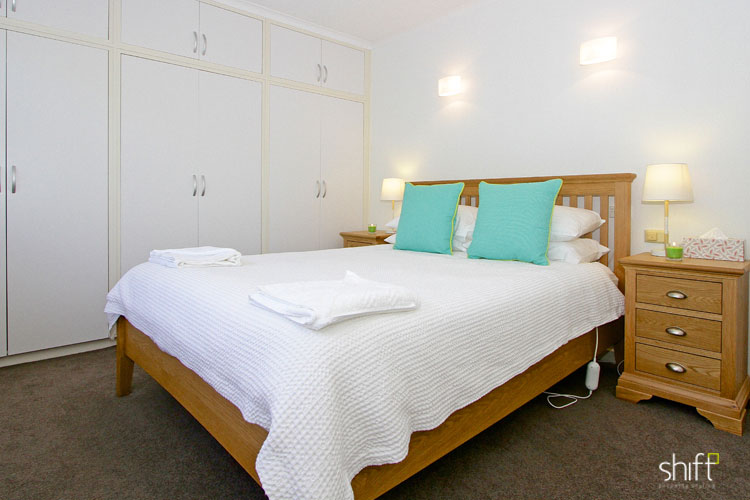 Master bedroom in a short stay holiday let in Hobart styled for guests to arrive.
