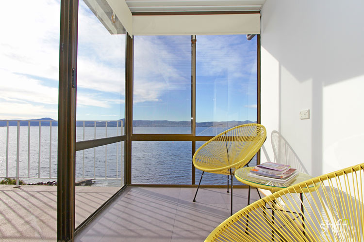 This sunroom was enhanced with some additional seating to take advantage of the wonderful view