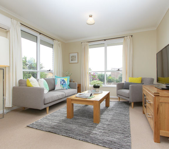Lounge room styled for sale in this unit