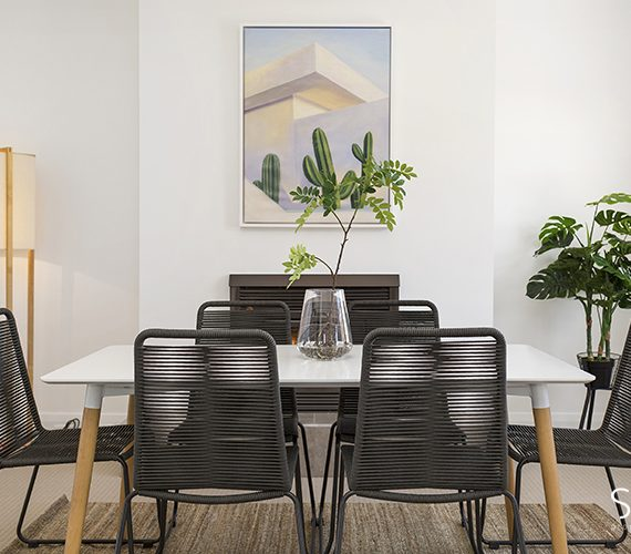 Funky dining chairs in this modern dining.
