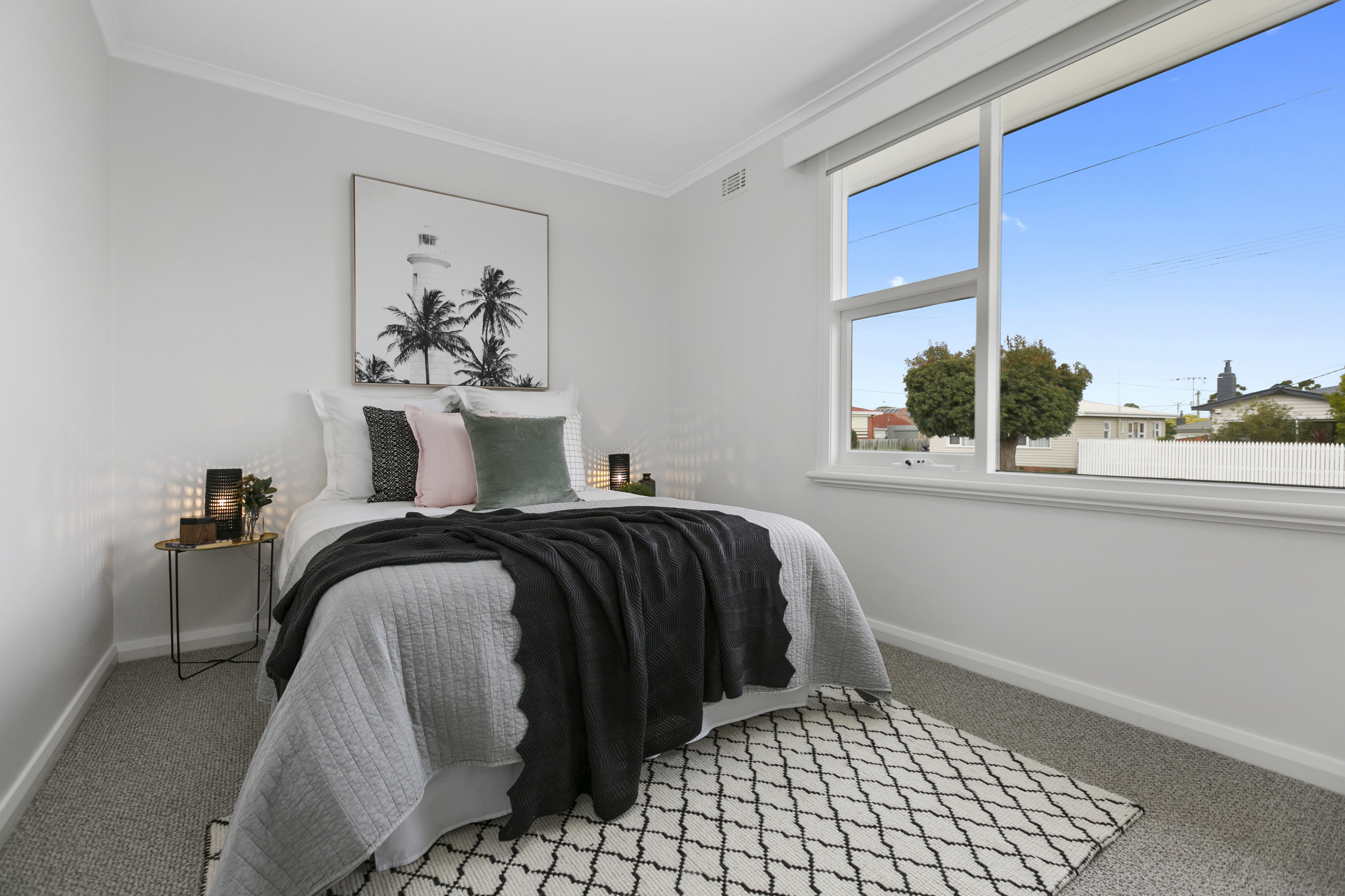 Guest bedroom styling with pops of blush